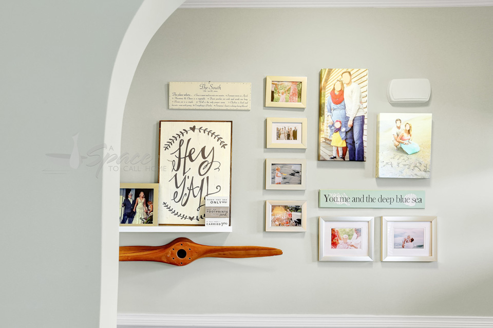 Collage Wall in Foyer - Coastal Home Design